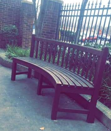 the crescent-shaped bench